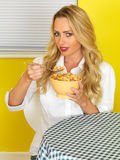 Young Woman Eating Breakfast Cereal Flakes Royalty Free Stock Images