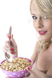 Young Woman Eating Breakfast Cereals Royalty Free Stock Photos