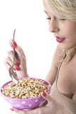 Young Woman Eating Breakfast Cereals Royalty Free Stock Image