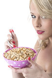 Young Woman Eating Breakfast Cereals Stock Photos