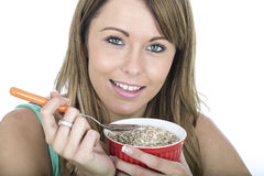 Young Woman Eating Breakfast Cereals Stock Photography