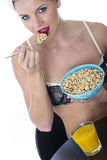 Young Woman Eating Breakfast Cereals Lingerie Stock Photo