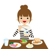Young woman eating breakfast Stock Photo