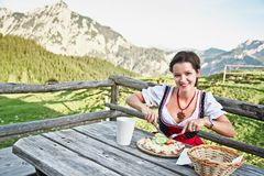 Young Woman eating Brettljause royalty free stock photos