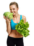 Young woman eating cabbage and holding lettuce in her hand, organic food, health and beauty care concept Stock Photography