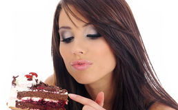 Young woman eating the cake. Stock Images