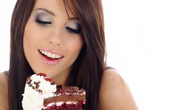 Young woman eating the cake. Royalty Free Stock Image