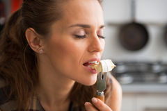 Young woman eating camembert Stock Photography