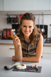 Young woman eating camembert Royalty Free Stock Photography