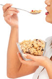 Young woman eating cereal breakfast Stock Photos