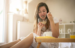 Young woman eating cereal. royalty free stock photos