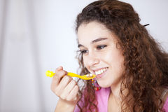 Young woman eating cereals Stock Photo