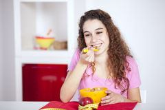 Young woman eating cereals Stock Image