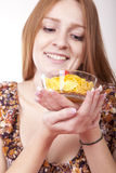 Young woman eating cereals. Beautiful young woman aeating cereals with strawberries Royalty Free Stock Image