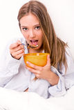 Young woman eating cereals Stock Images