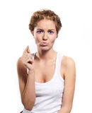 Young woman eating chewing gum Royalty Free Stock Images