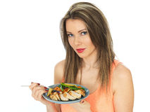 Young Woman Eating Chicken with Mixed Vegetables Stock Photography