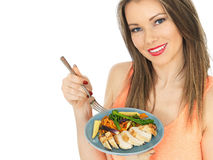 Young Woman Eating Chicken with Mixed Vegetables Royalty Free Stock Photo
