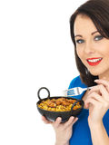 Young Woman Eating Chicken Tikka Biryani Stock Images