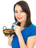 Young Woman Eating Chicken Tikka Biryani Royalty Free Stock Photo