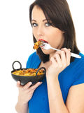 Young Woman Eating Chicken Tikka Biryani Royalty Free Stock Images