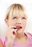 Young woman eating chocolate. Stock Photography