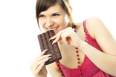 Young woman eating chocolate Stock Photo
