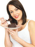Young Woman Eating Chocolate Cake Royalty Free Stock Image