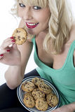 Young Woman Eating a Chocolate Chip Cookie Biscuit Royalty Free Stock Image