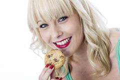 Young Woman Eating a Chocolate Chip Cookie Biscuit Stock Photos