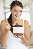 Young Woman Eating Chocolate Ice-Cream Stock Photo