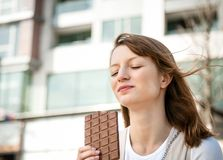 Young woman eating chocolate Stock Photos