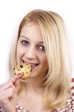 Young woman eating cookie Royalty Free Stock Photos