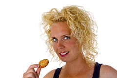 Young woman eating cookie Royalty Free Stock Images