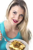 Young Woman Eating a Cottage Pie Royalty Free Stock Photo