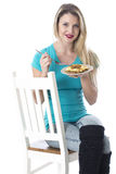 Young Woman Eating a Cottage Pie Stock Image