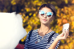 Young Woman Eating Cotton Candy Stock Images