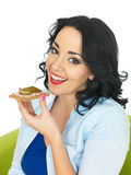 Young Woman Eating a Cracker with Sliced German Sausage and Gherkin Royalty Free Stock Photography