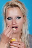 Young woman eating cream Stock Photography