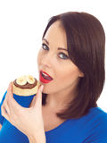 Young Woman Eating Crumpet with Chocolate Spread and Banana Stock Image