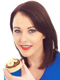 Young Woman Eating Crumpet with Chocolate Spread and Banana Royalty Free Stock Photos