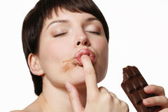 Young woman eating a delicious chocolate Stock Photo