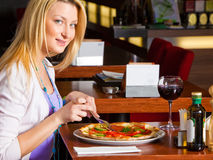 Young Woman Eating Dinner Stock Photos