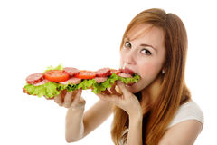 Young woman eating fast food stock photos