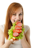 Young woman eating fast food Royalty Free Stock Photos
