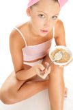 Young woman eating flakes Royalty Free Stock Photos