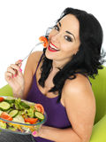 Young Woman Eating a Fresh Crisp Mixed Garden Salad Royalty Free Stock Photo