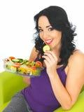 Young Woman Eating a Fresh Crisp Mixed Garden Salad Stock Photo