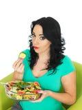 Young Woman Eating a Fresh Crisp Mixed Garden Salad Stock Photos