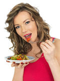 Young Woman Eating a Fresh Crispy Garden Salad Stock Images